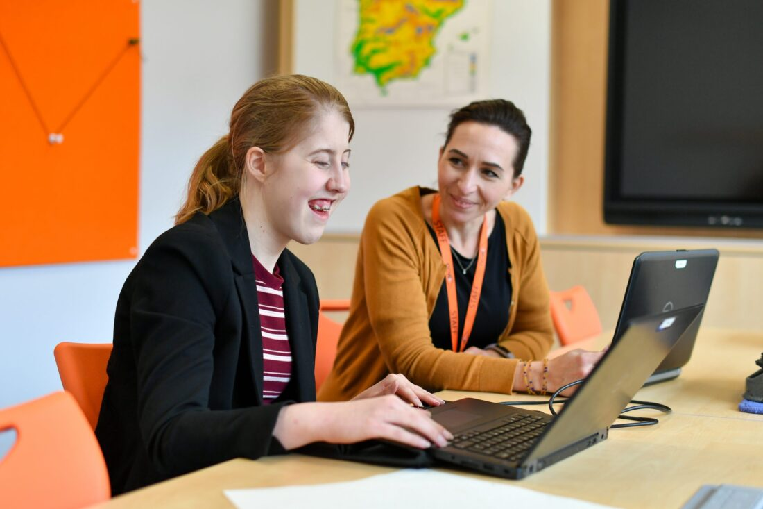 Student and Teacher studying Modern Foreign Languages with laptop