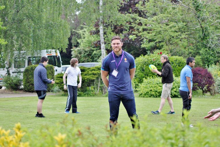 Students playing Hugby with Warriors player, Darren Barry
