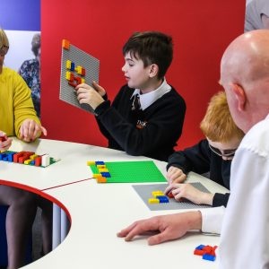 Students and staff using LEGO Braille Bricks in Mathematics