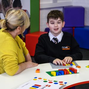 Student with Teacher using Braille Bricks in Maths