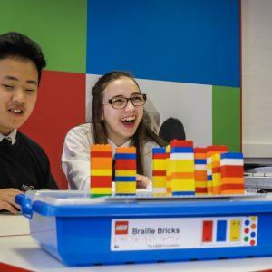 Students using Braille Bricks
