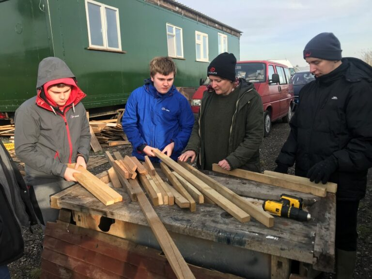 Toby, Corey and DJ learning how to cut wood