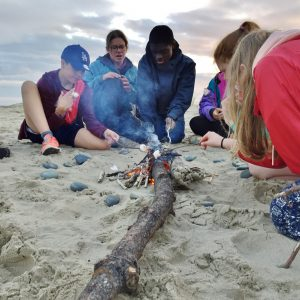 Creating fire on the beach!
