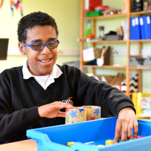 Male student with Braille Lego