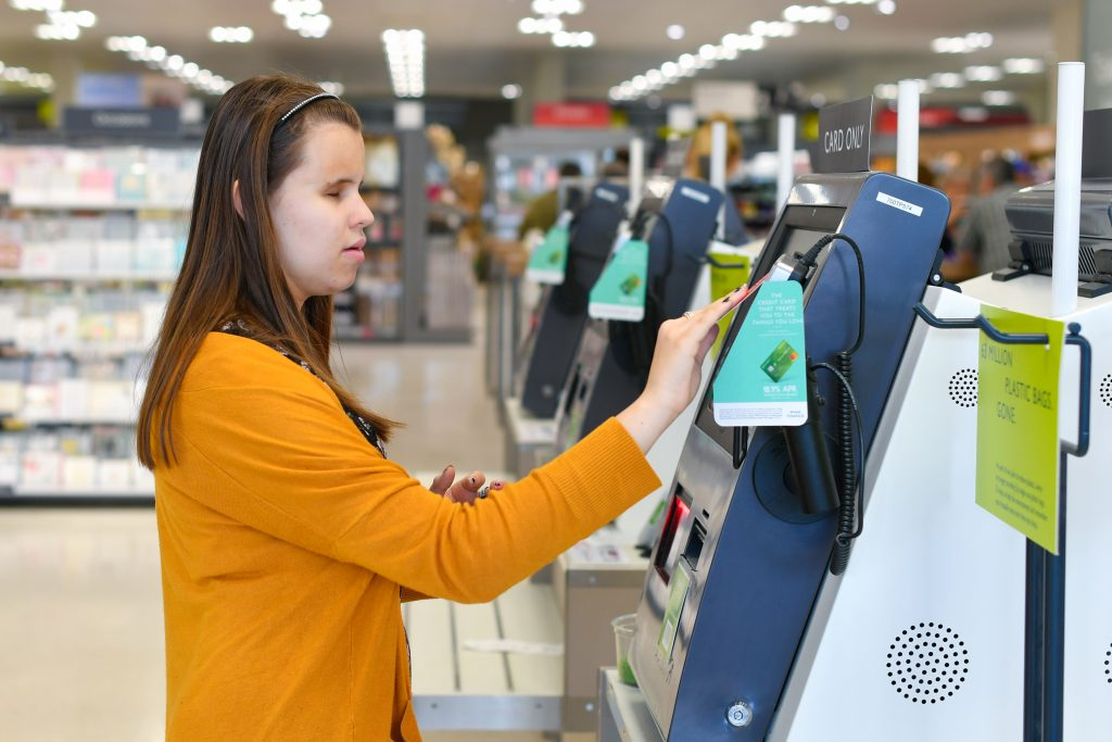 Student using self service checkout