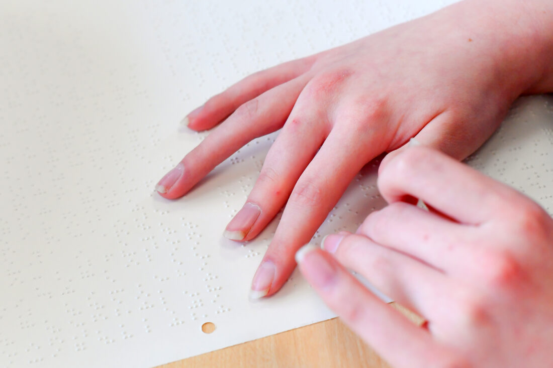 Fingers using Braille