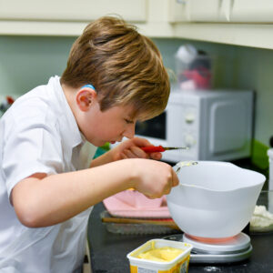 Student in the ILS kitchen weighing out ingredients on talking scales