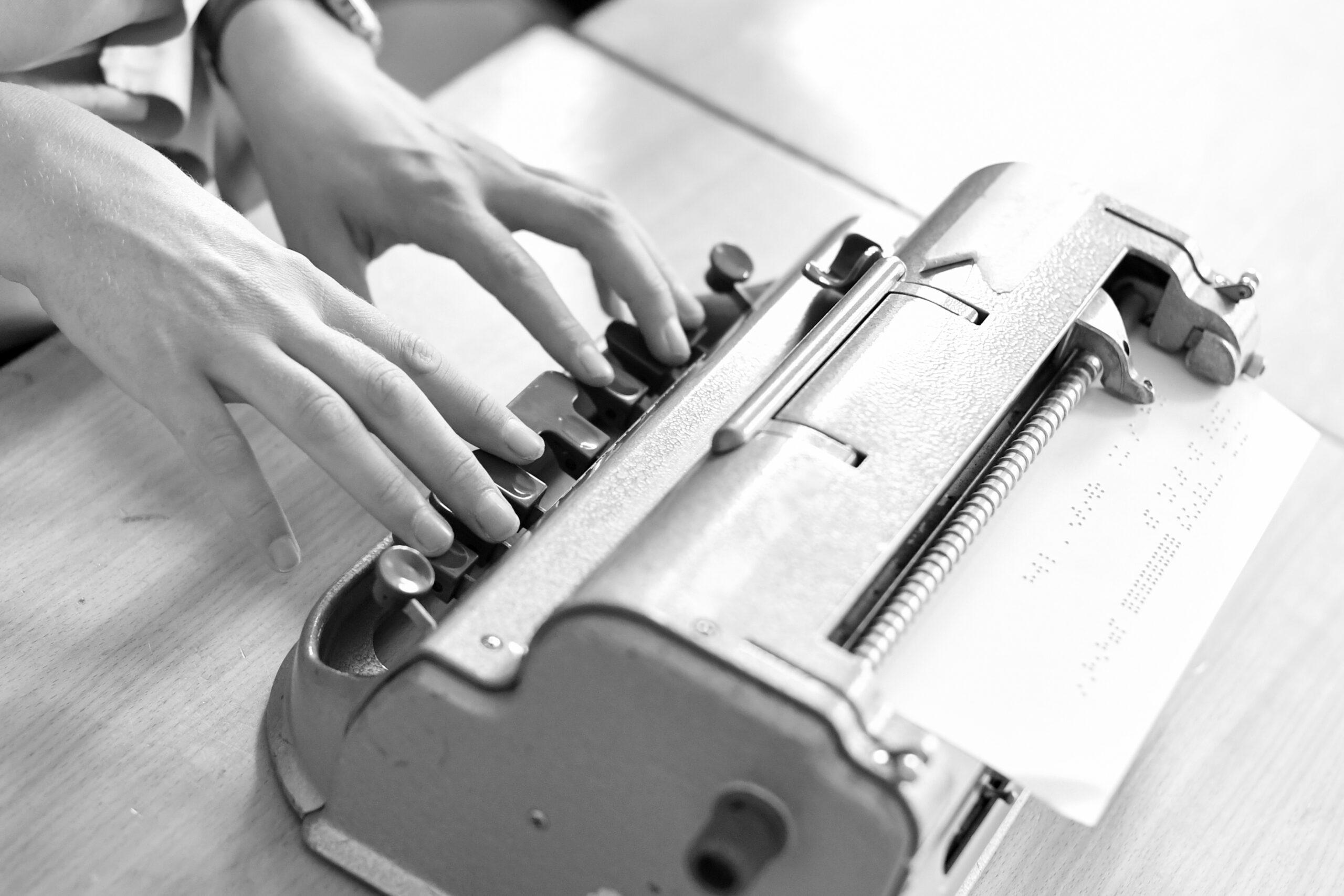 Perkins Brailler with hands