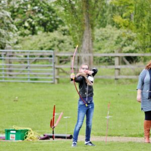 Young person doing Archery on the playing fields at NCW