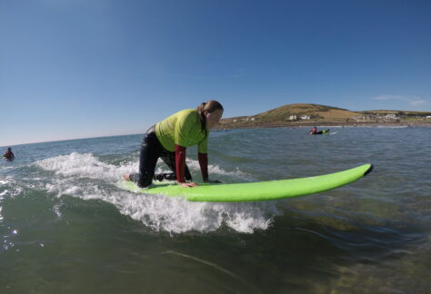 Student surfing in the sea