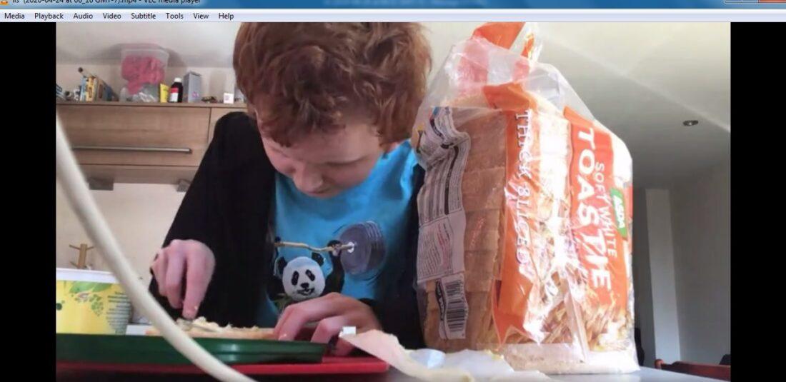 Joe learning to butter bread via video link