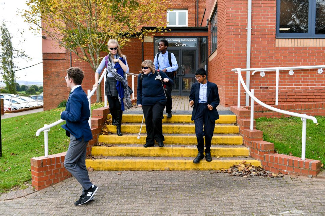 Students walking down steps