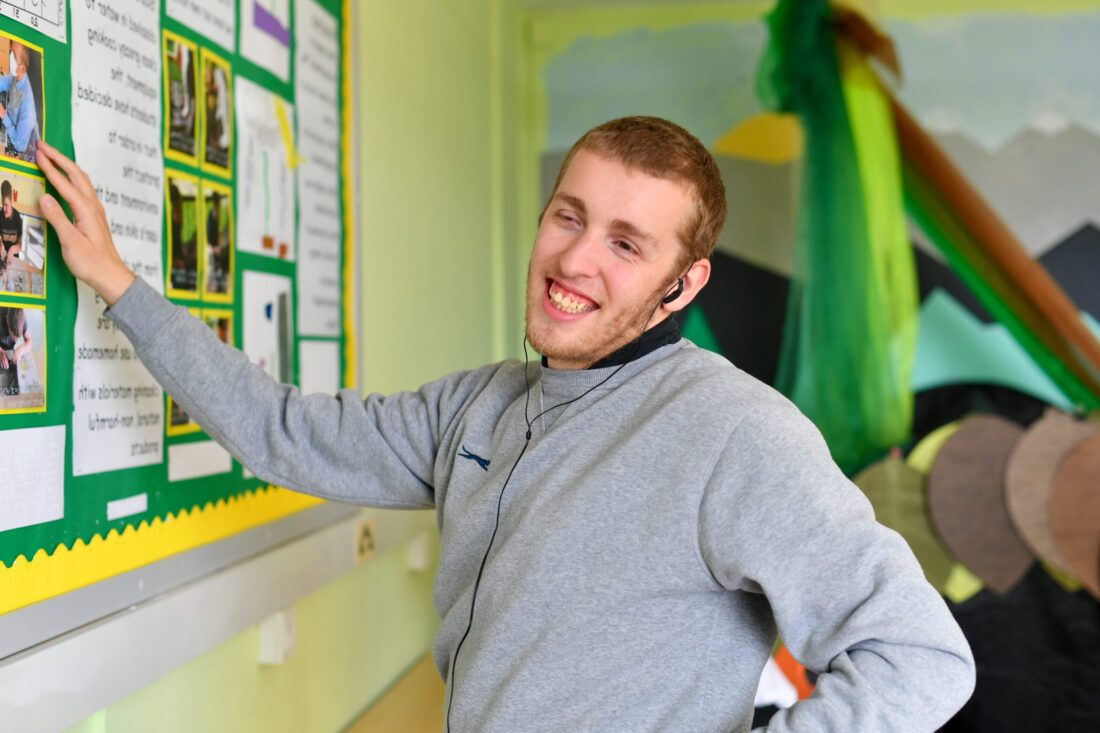 Student DJ using tactile wall displays in the colourful Malvern Room