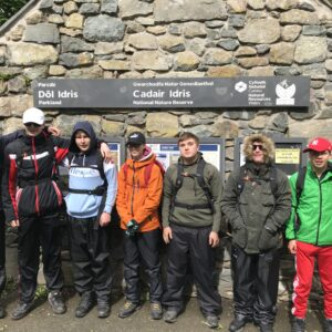 Students posing for a photo at the foot of Cadair Idris before they start the climb