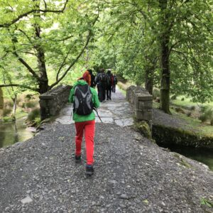 Tom W walking over a picturesque looking bridge