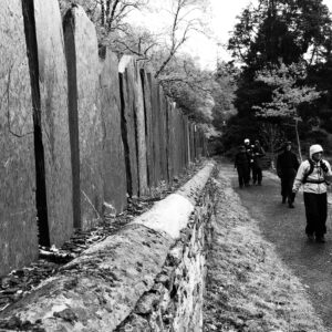 Black and white photograph of the group plodding on