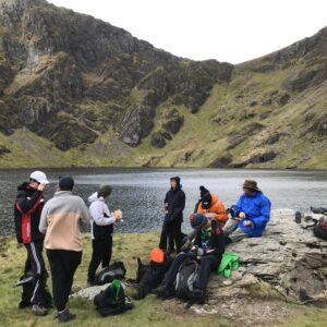 Another view of the beautiful lake with students in the forefront stopping for their snack!