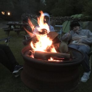 The fire roaring as the sky begins to get dark