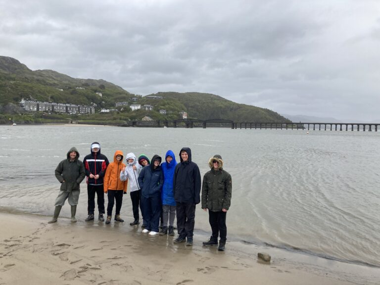 Posing for a photo at the shoreline - not looking very happy because of the weather!