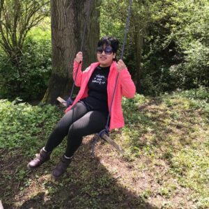 Student Rahel on a homemade tree swing