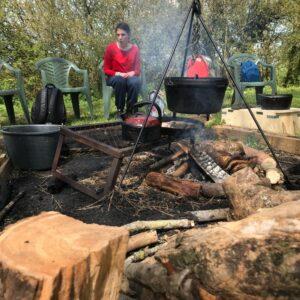 Millie sat around the camp fire