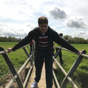 Jack walking across the bridge