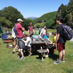 The group gathered on a picnic bench on the campsite