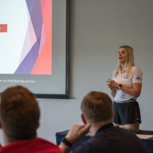 British Blind Sport delivering a talk using a powerpoint presentation on screen