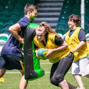 Megan from NCW Activities Team rugby tackling one of the padded shields