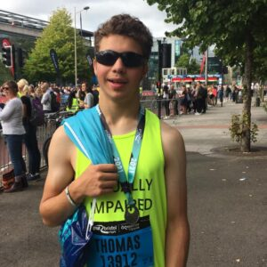 Tom with his medal just after the race