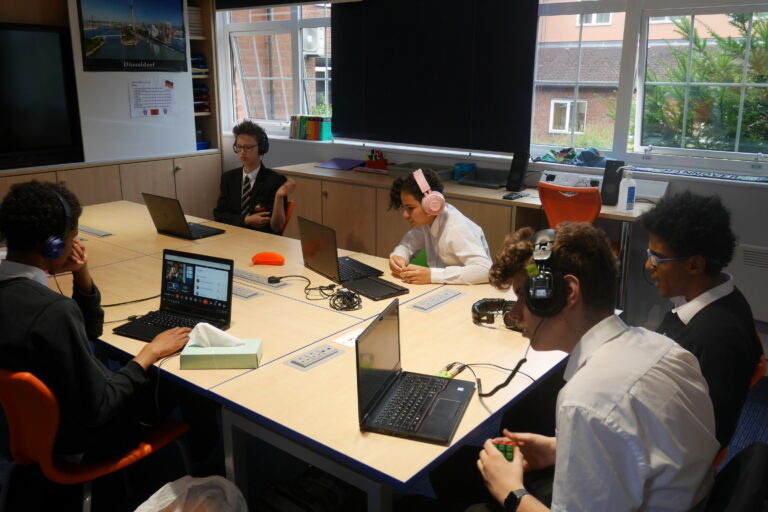 Students receiving a remote Spanish lesson from Spain