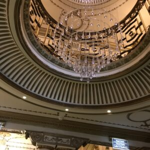The beautiful ceiling and chandelier in the Victoria Palace Theatre