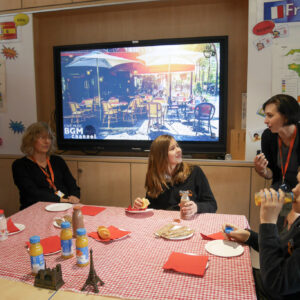 View of Ms Molina's room, set up for French breakfast complete with music on the TV screen