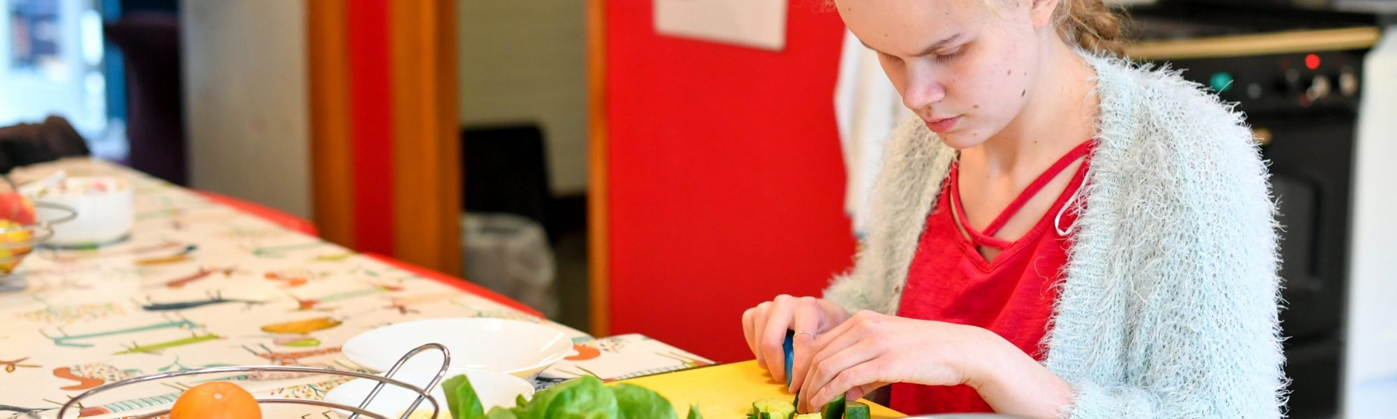 Student chopping vegetables
