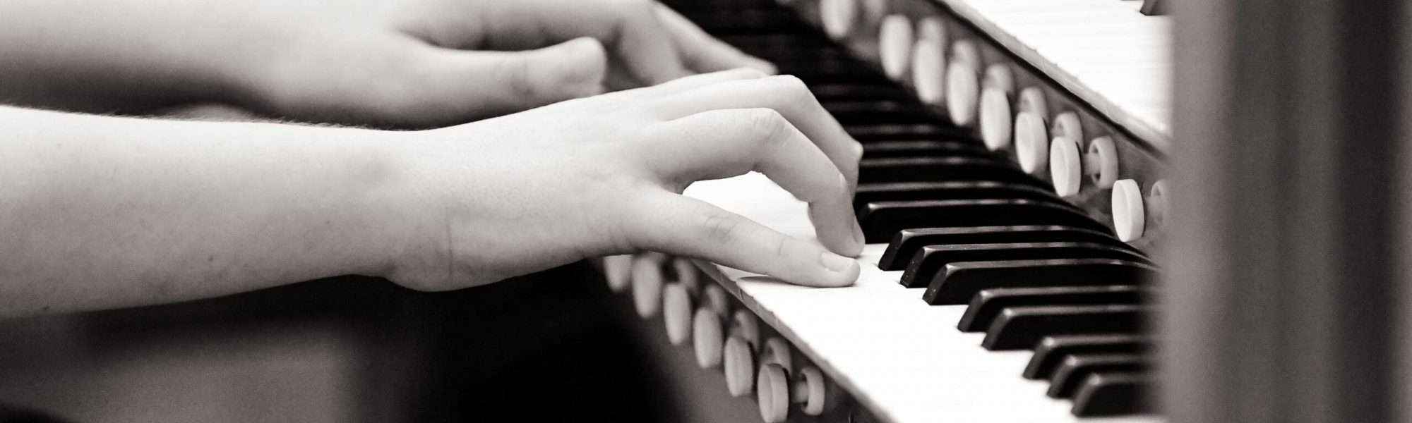 Close up of student playing piano